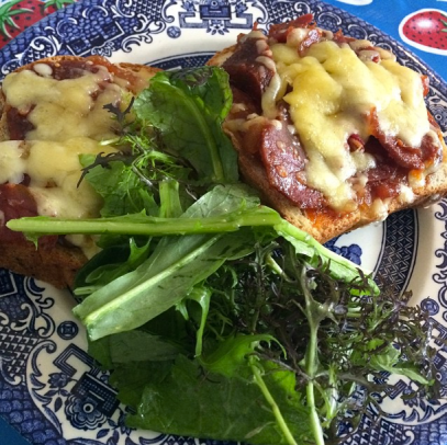 An open-faced sandwich with chutney, cheddar and Irish chorizo and a side of greens at The Cake Café.