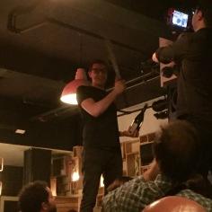 Swashbuckling Pearl & Ash Wine Director Patrick Cappiello sabering champagne